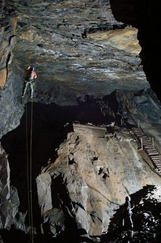 Abseiling from lofty heights underground adventure exploring caving